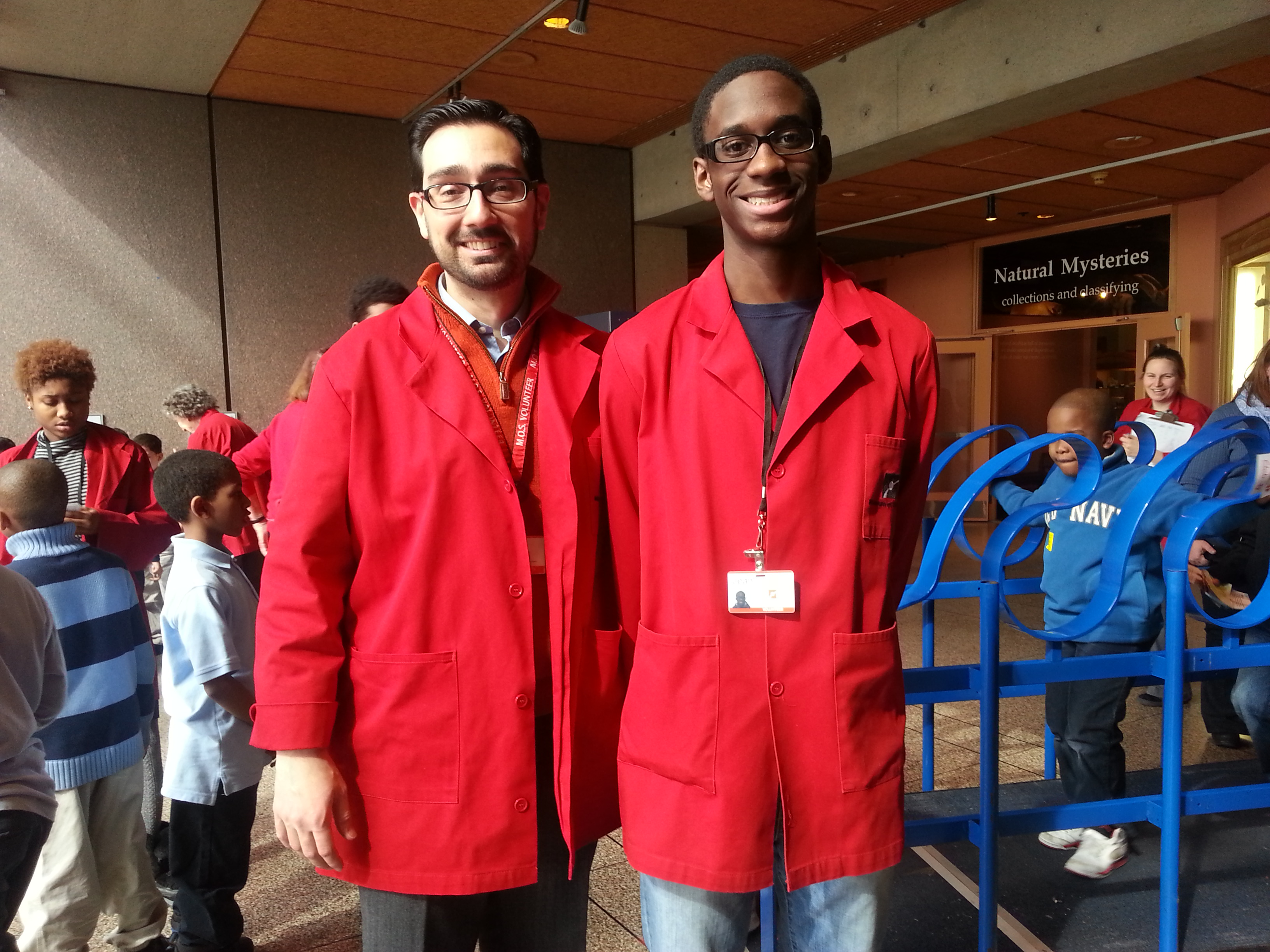 educators in red coats.