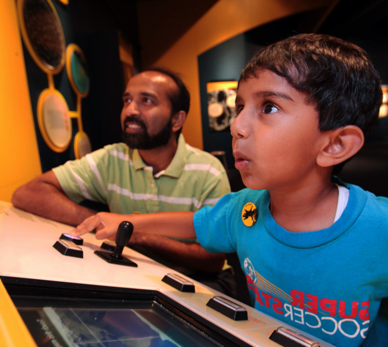 Picture of man and boy at exhibit