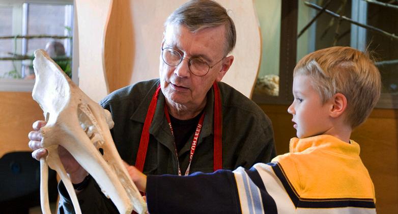 Picture of volunteer and boy in exhibit
