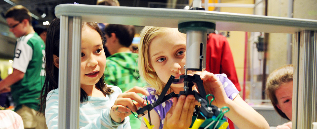 Two girls at Design Challenges drop-in activity