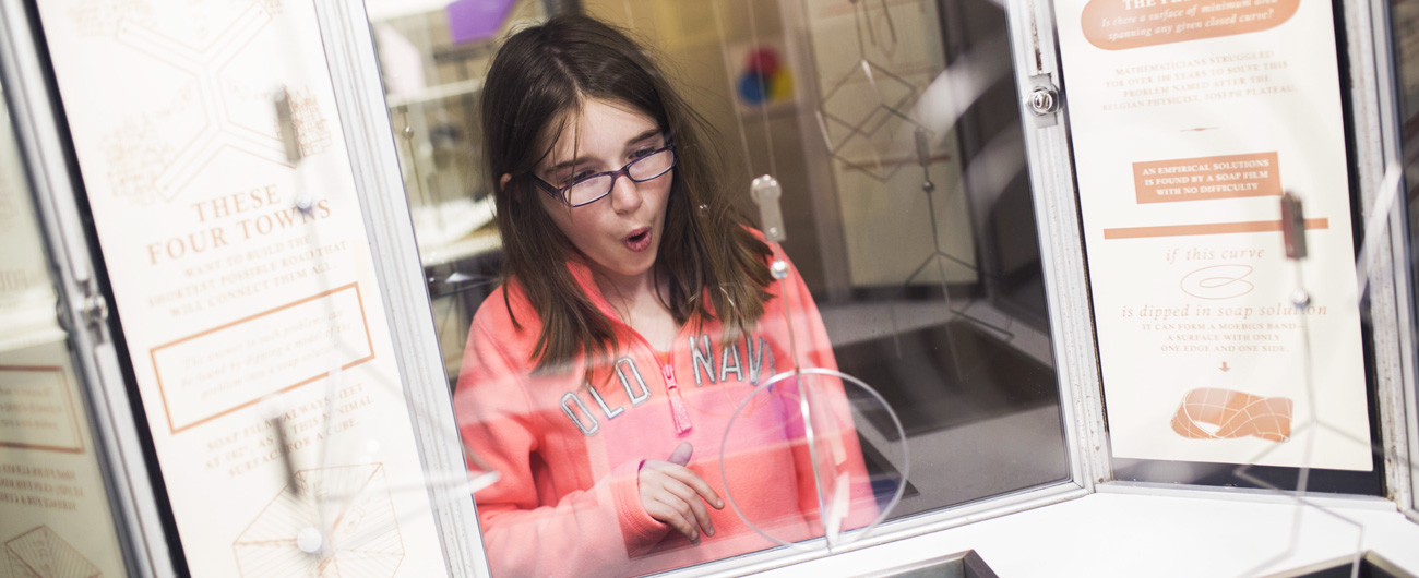 Photo of girl in Mathematica exhibit