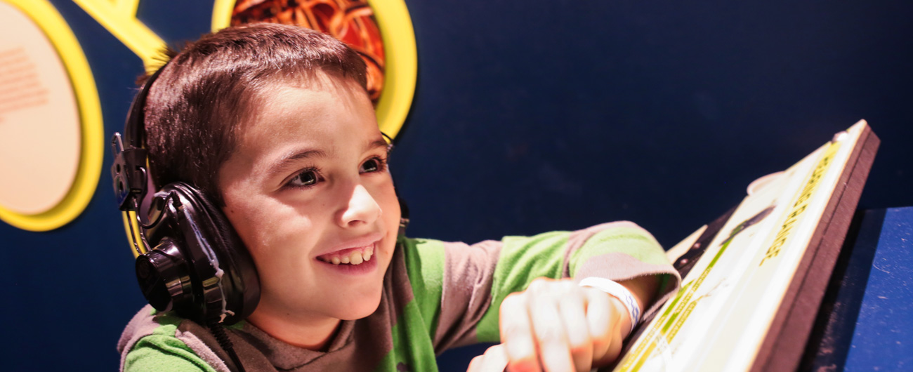 Boy in Take a Closer Look exhibit