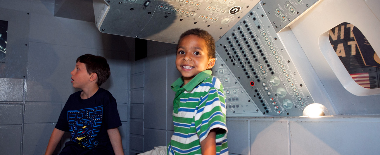 Boys in the To the Moon exhibit