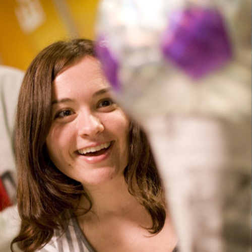 girl smiling at trophy stem activity