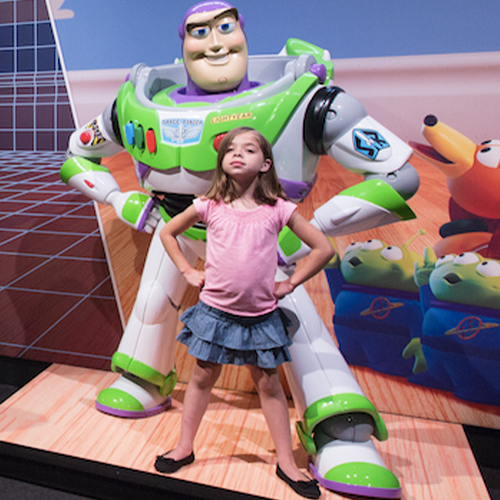 Young girl poses with life-sized model of Buzz Lightyear