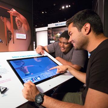 Students in The Science Behind Pixar exhibit
