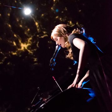 Woman singing in the Planetarium.