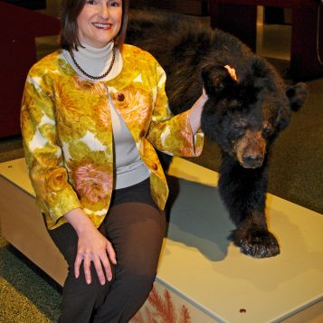 "On May 7, the White House honors Christine Reich as a ""Champion of Change"" for her work with the Museum of Science, Boston in science, technology, engineering, and math (STEM) education for people with disabilities. Here, Reich gets ""hands-on"" with a bear mount in New England Habitats, the first exhibit the Museum renovated with feedback from people with disabilities. The Museum added audio labels, smell boxes, touchable animal specimens, and other activities, engaging all the senses and making the exhibit"
