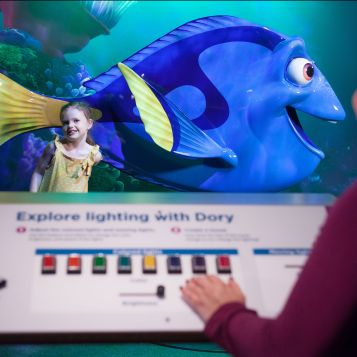 Visitors adjust lighting to recreate a scene from Finding Nemo