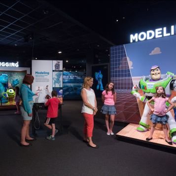 Visitors explore human-size models of some of their favorite Pixar characters, including Buzz Lightyear, and Mike & Sulley