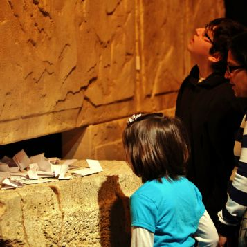 Visitors explore the <em>Dead Sea Scrolls</em> exhibit.