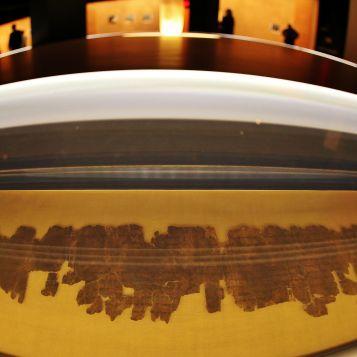 Visitors explore the <em>Dead Sea Scrolls</em> exhibit.